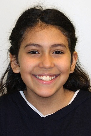 Young girl with beautiful smile after orthodontic office