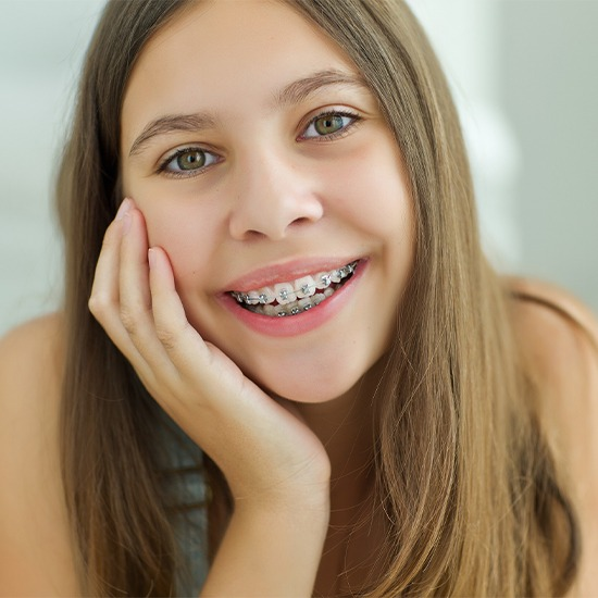 Teen girl with self ligating braces smiling